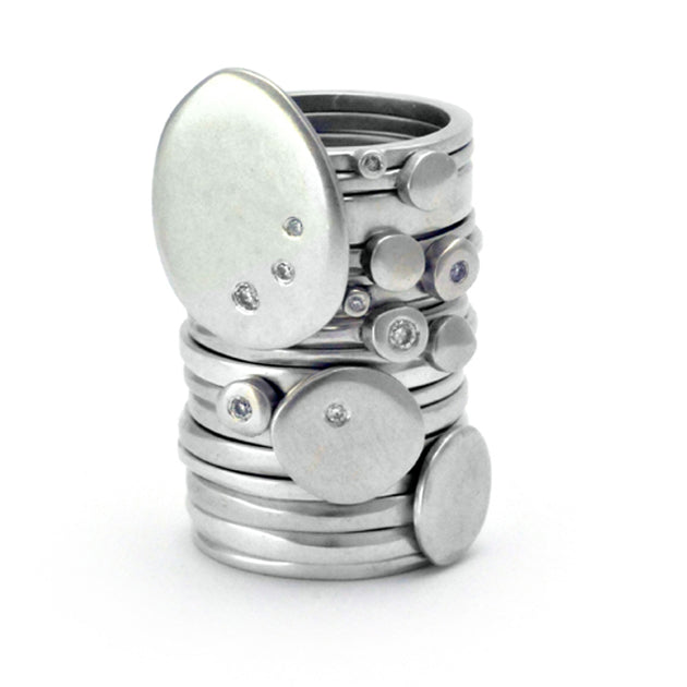 Gorgeous stack of silver diamond rings by designer jeweller Annika Rutlin