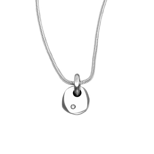 A delicate silver pebble pendant with a high quality diamond by jewellery designer Annika Rutlin