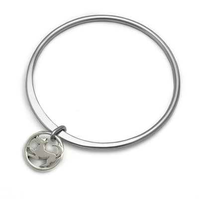Forged solid silver round bangle with dog charm by Annika Rutlin