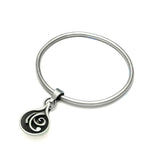 swirly silver patterned tear droplet bangle from the Monsoon Collection