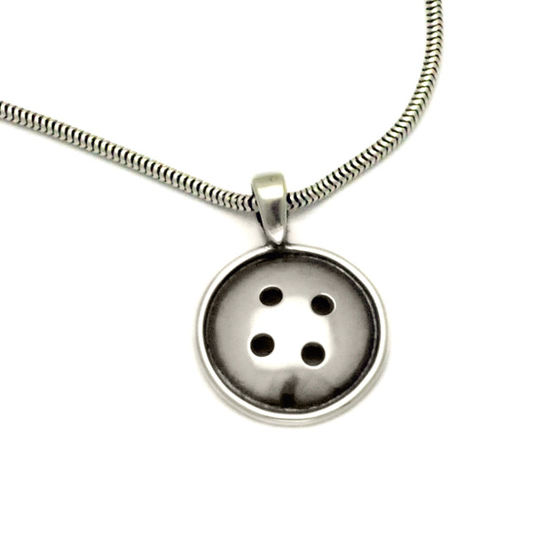 Sterling silver button pendant by jewellery designer Annika Rutlin