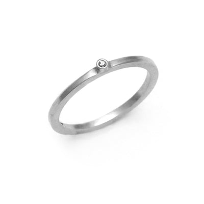 delicate small single white diamond silver band ring Annika Rutlin