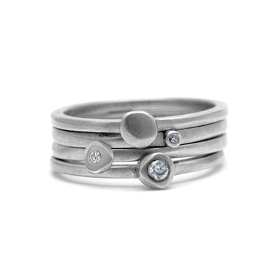 gorgeous silver stacking ring set of 4 plain and diamond rings by Annika Rutlin