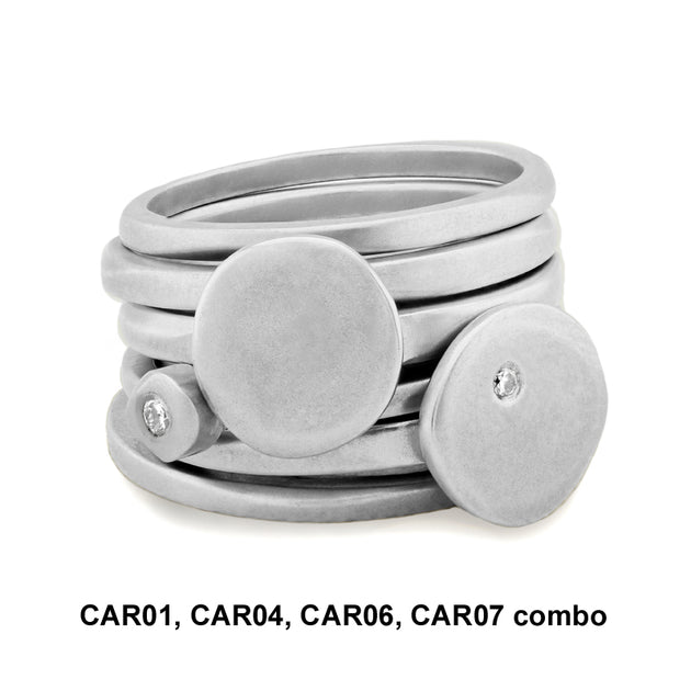 stack of 6 silver and diamond rings from the Cairn collection by Annika Rutlin