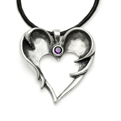Solid silver winged pendant set with an amethyst gemstone by Annika Rutlin