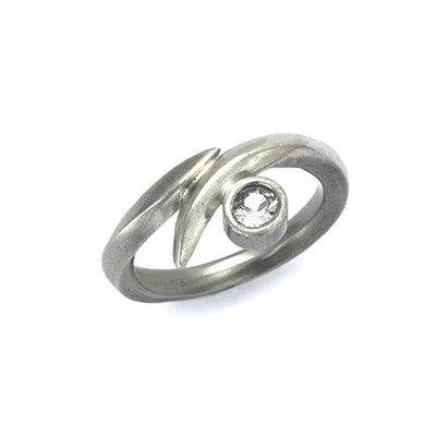 Solid silver wrap ring set with 4mm white saphire by Annika Rutlin