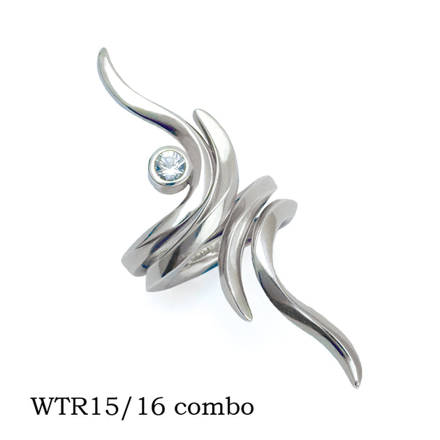 Annika Rutlin designer Eagle pose inspired interlocking silver sapphire rings