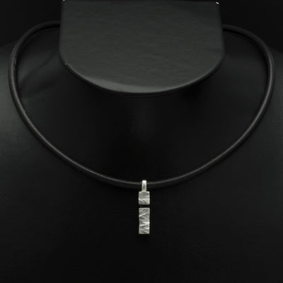 Ixion silver pillar pendant on leather XP49-LE