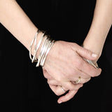 stacked silver interlocking bangles Annika Rutlin
