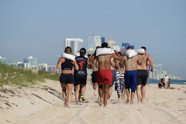 sand bag and running in the beach miami