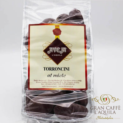 Torroncini al miele:  Cookie with hazelnut, honey & rum in a dark chocolate shell