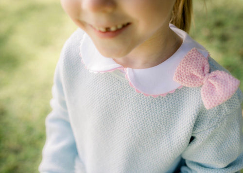 Blue sweater w/ Pink Bow