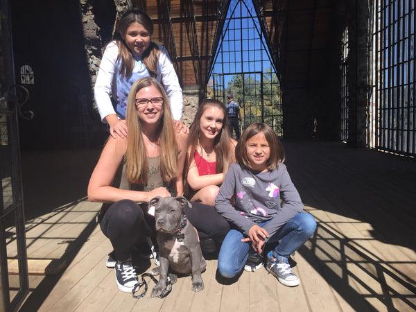 Kathy, Sarah, Lily and Emma with Diesel the Pit Bull in the great room and Bishop's Castle Colorado