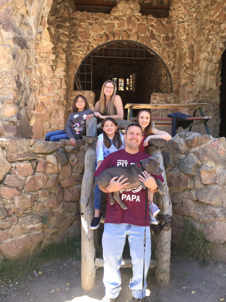 John, Kathy, Sarah, Lily, Emma and Diesel in the big chair at Bishop's Castle in Colorado