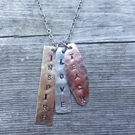 https://shopthemakers.com/products/teach-love-inspire-hand-stamped-necklace