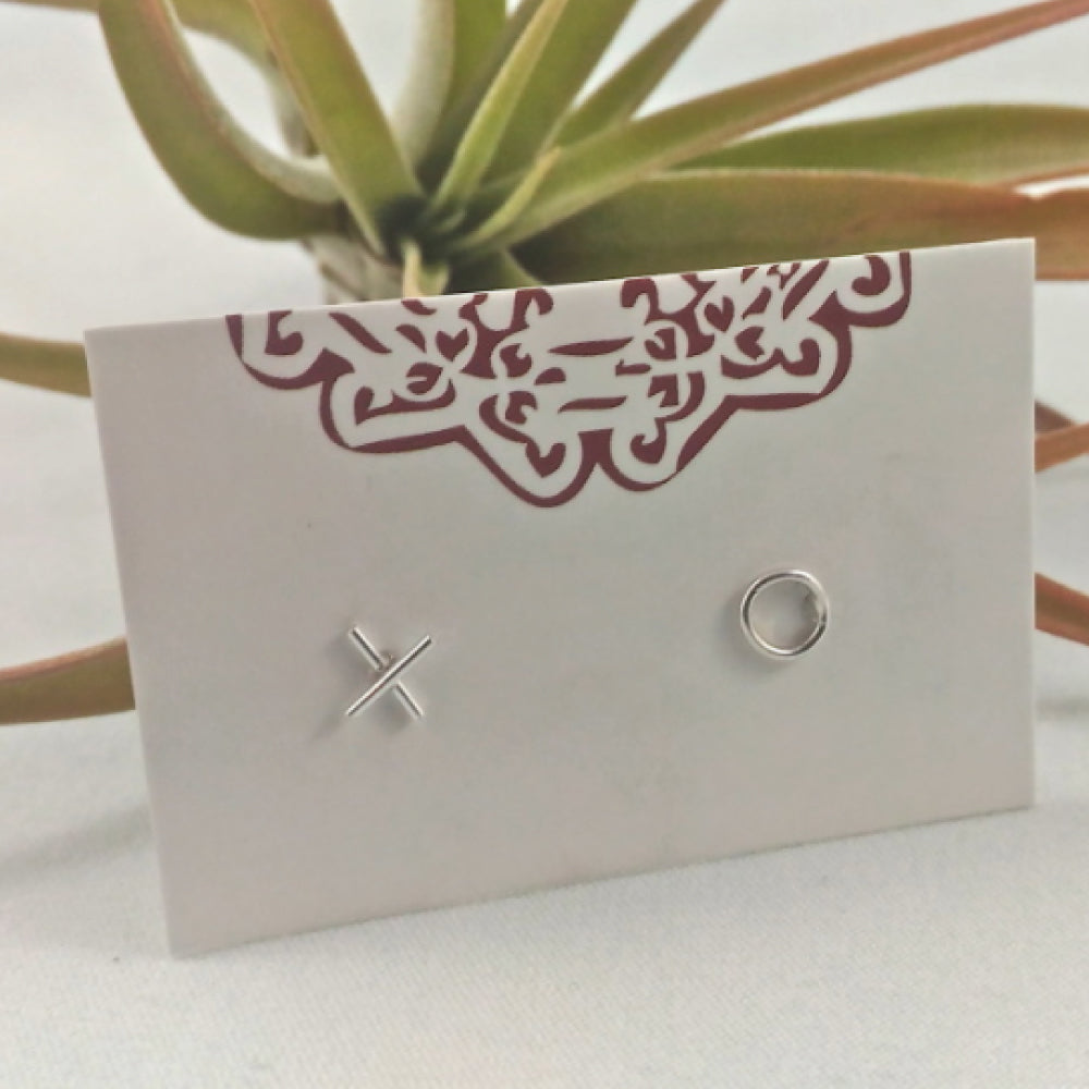 https://shopthemakers.com/collections/earrings/products/xo-mini-studs-sterling-silver