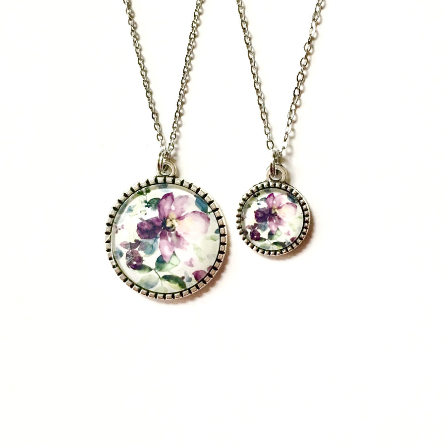 https://shopthemakers.com/products/matching-mother-daughter-necklace-set-purple-floral