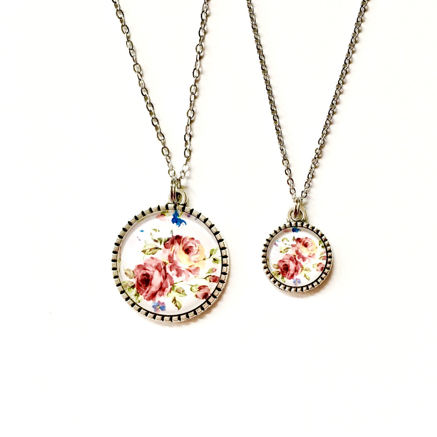https://shopthemakers.com/products/matching-mother-daughter-necklace-set-coral-floral