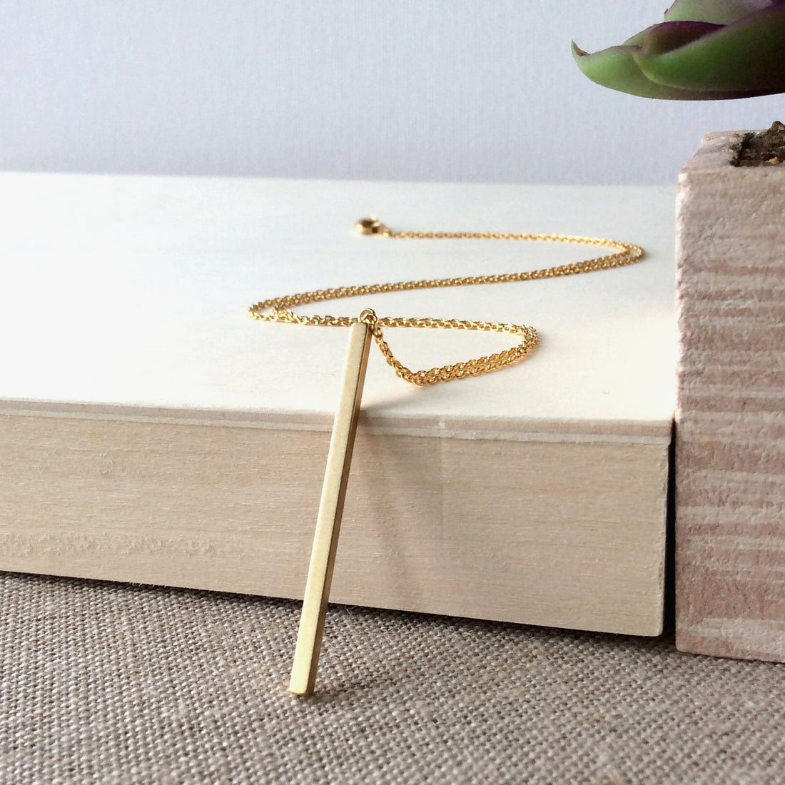 https://shopthemakers.com/products/matte-gold-stick-necklace-gold-pendant-necklace-thin-bar-pendant-necklace-casual-necklace-gold-bar-necklace-matte-gold-necklace