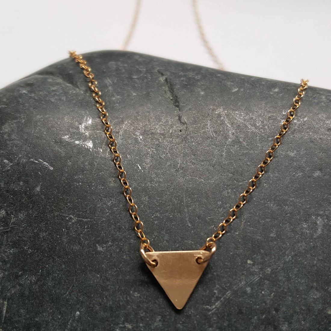 https://shopthemakers.com/products/tiny-gold-triangle-necklace