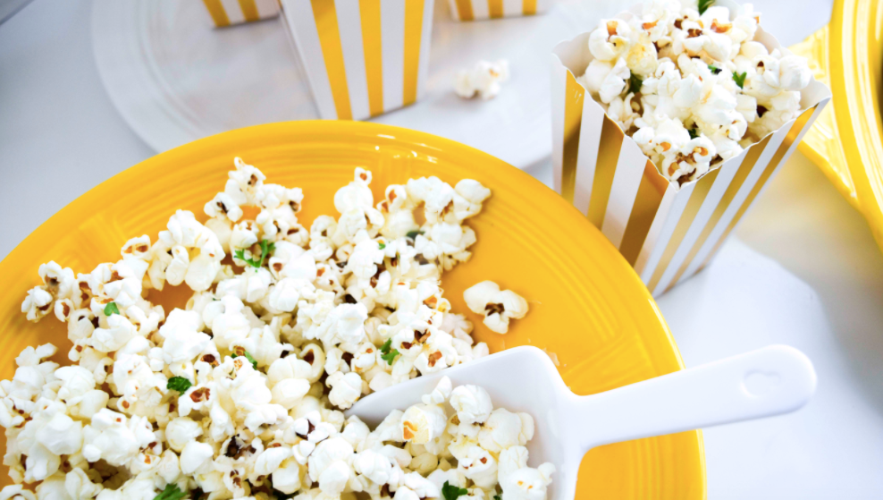 Yellow plate with popcorn