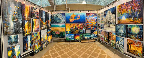 Nelson Makes Art booth at ArtFest Midwest art show in Des Moines, Iowa. Art festival booth with 3 walls covered in colorful tropical paintings