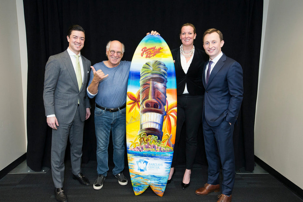 Jimmy Buffett with the surfboard painted by Nelson