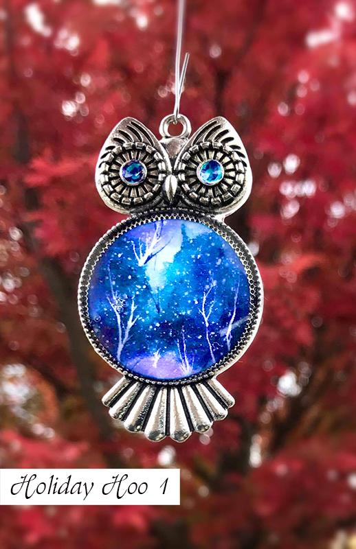 Silver owl Christmas tree ornament with blue and white painted chest and swirled eyes for blue Christmas decoration ideas.