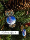 Silver and blue owl Christmas tree ornament with watercolor painting on chest and swirled eyes. Perfect Kappa gift idea.