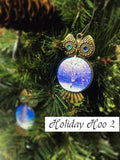 Bronze owl Christmas tree ornaments with blue jewel eyes and painted christmas card stomach prints.