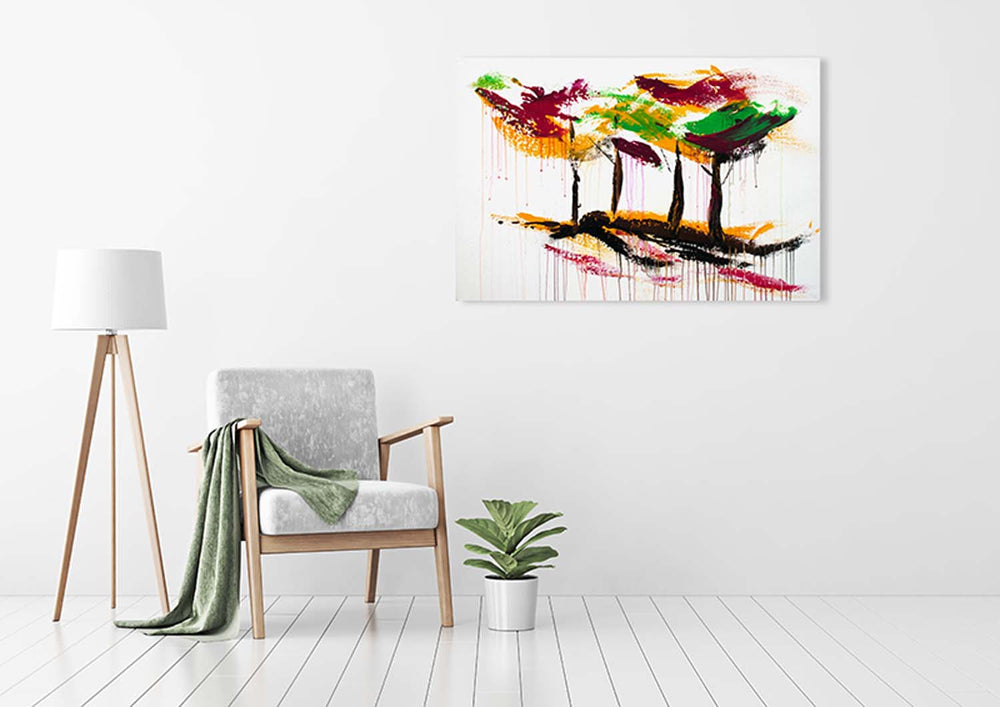 Original abstract wall art of colorful forest with magenta, green, yellow, and black trees as sen décor in an urban loft