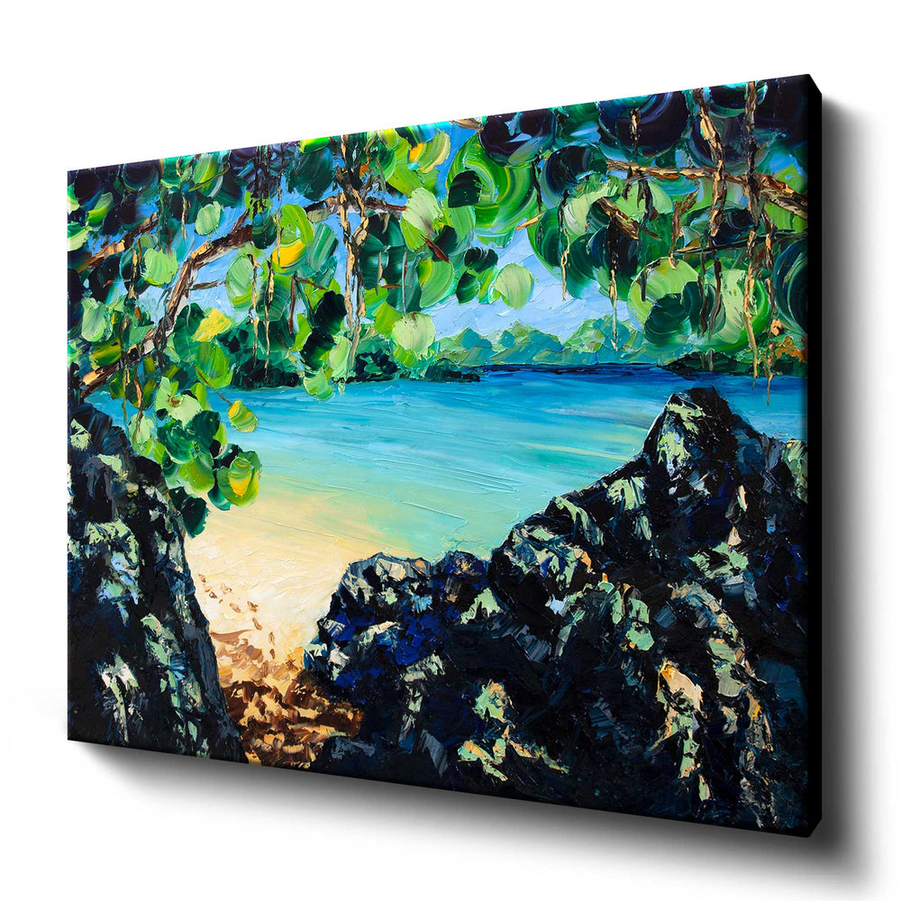 Printed art canvas of lush tropical beach on a blue lagoon with sandy footprints in the sun