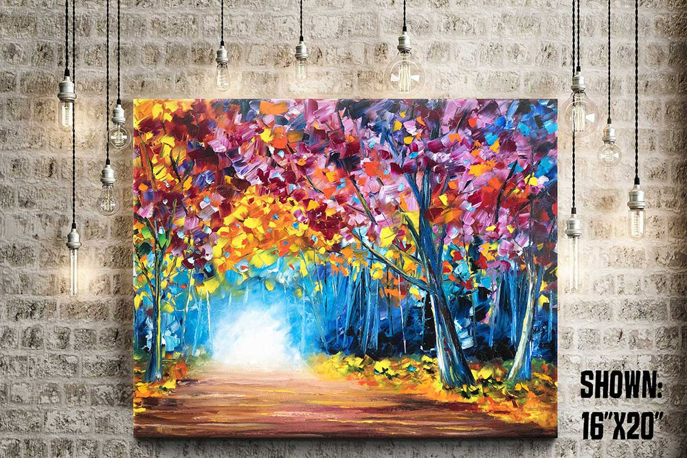 Large wall art on canvas of a colorful fall forest with a glowing path leading through the trees.