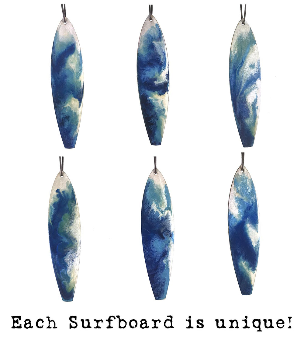 Blue Christmas ornament set with white painted swirls on carved wood surfboard Christmas ornament.