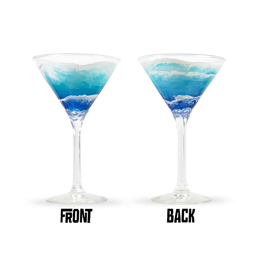 Pair of nautical themed martini glasses with hand-painted ocean waves washing around the glass. Perfect beach house decor.