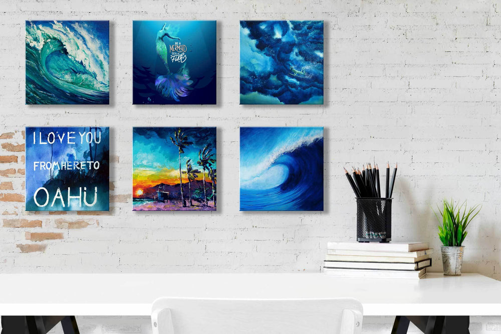 White home office idea with six art tiles of blue waves, tropical beaches, swimming surfers, and mermaids in shades of blue