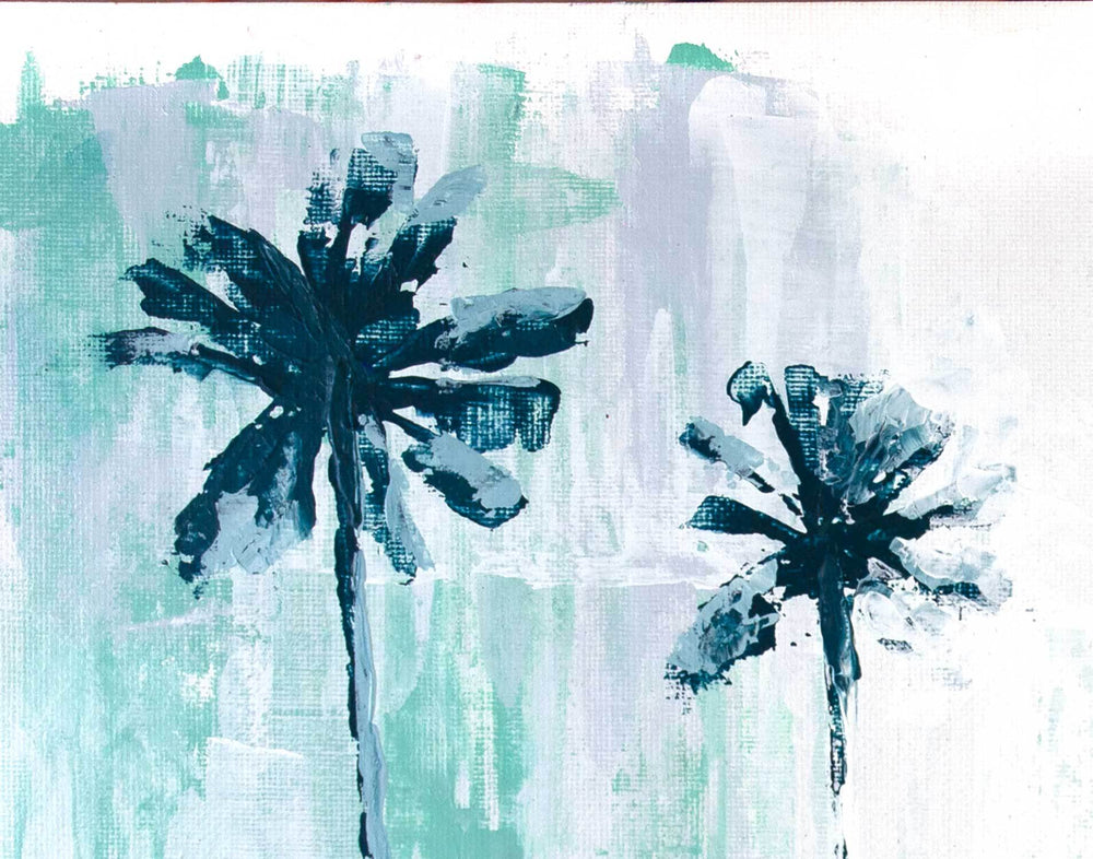 Minimalist beach house décor of palm tree silhouettes painted on gray zen background