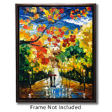 Framed autumn wall art of people walking a sunny forest path through a rainbow of fall foliage
