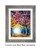 Framed nature wall art of a fall foliage landscape. Colorful foliage lines an inviting forest path in this fall decor for fireplace.