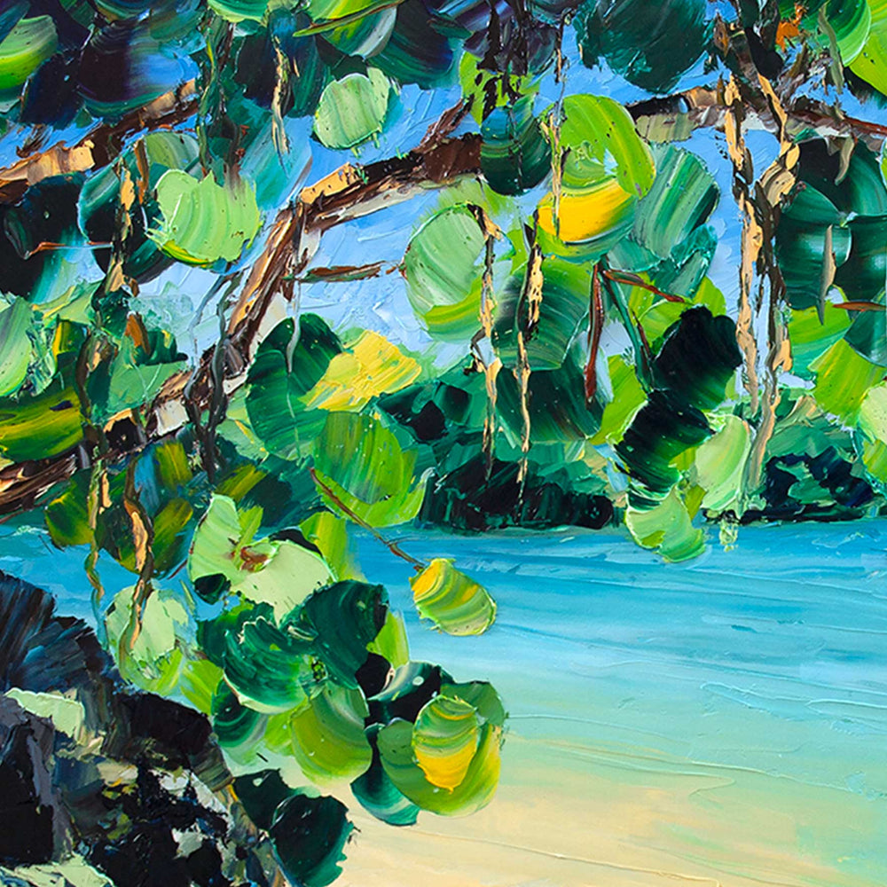 Kauai wall art of a secluded beach and lava rocks beside the bright blue Pacific Ocean