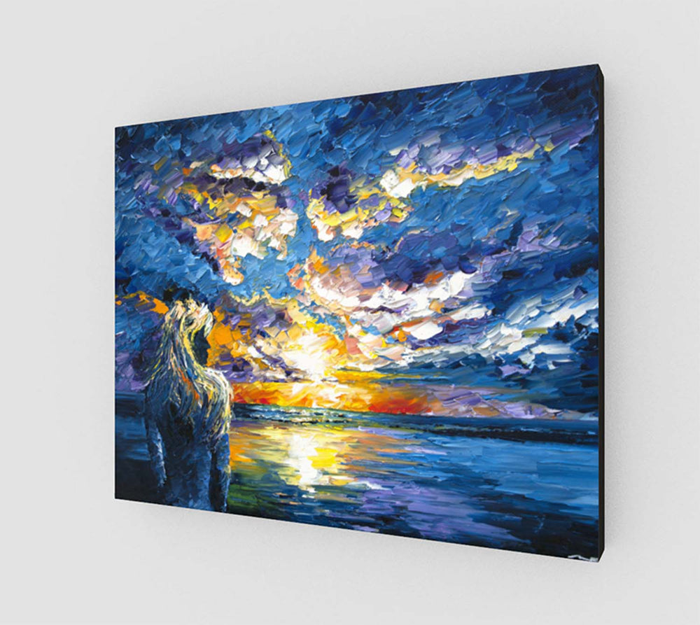 Stretched canvas print of a girl on the beach, watching the sunset over the blue ocean