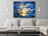 Extra large wall art of a blue and pastel sunset over the ocean in a trendy beach house