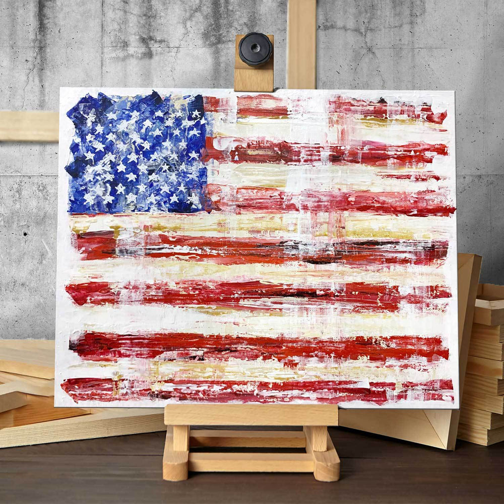 Original painting of American flag in rustic décor style, sitting on a small artist's easel