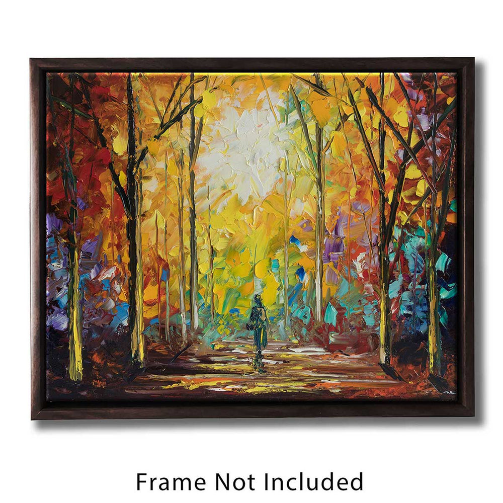 Framed autumn wall art of a figure walking a sunny forest path through a rainbow of fall foliage