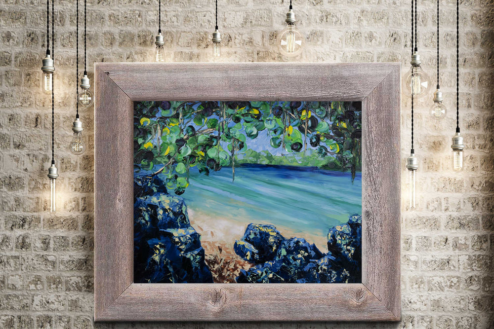 Nature wall art of a secluded beach on a clear blue lagoon surrounded by green tropical foliage