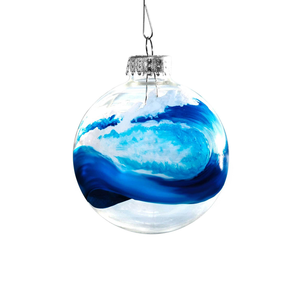 Big blue wave with closed curl painted on clear glass ball holiday ornament for your beach Christmas tree decor.