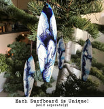 Coastal Christmas tree decorations with blue and white painted ocean swirls for surfing Christmas present idea.