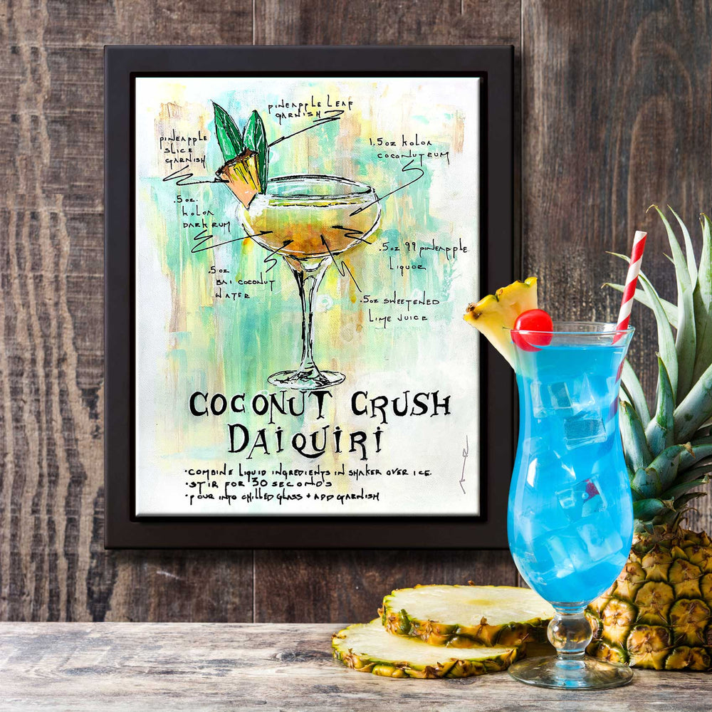 Home bar idea with framed daiquiri recipe wall art and fancy tropical drink on the bar