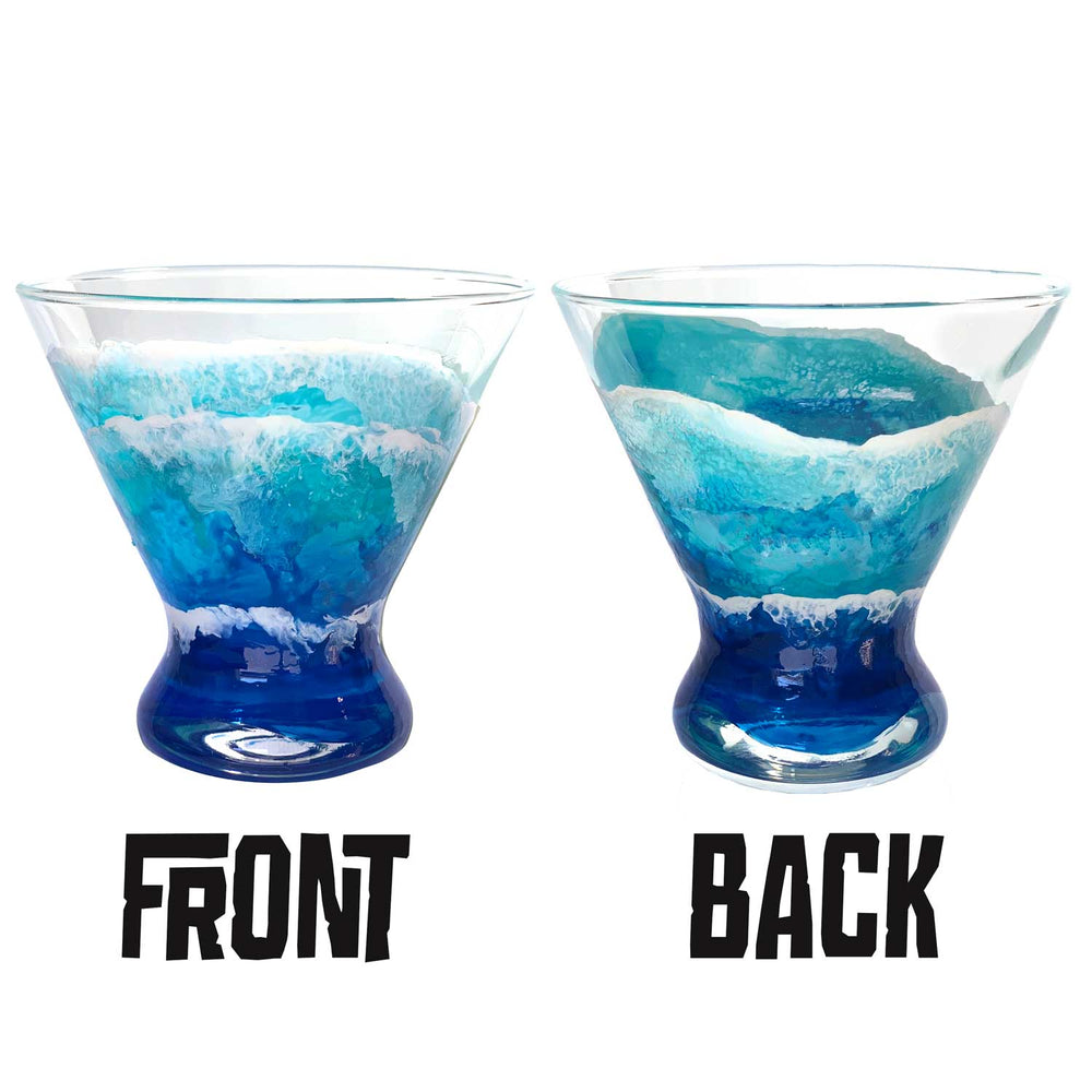 Set of beach barware with hand-painted waves by Nelson Makes Art. Positioned for nautical bar or beach house decor.