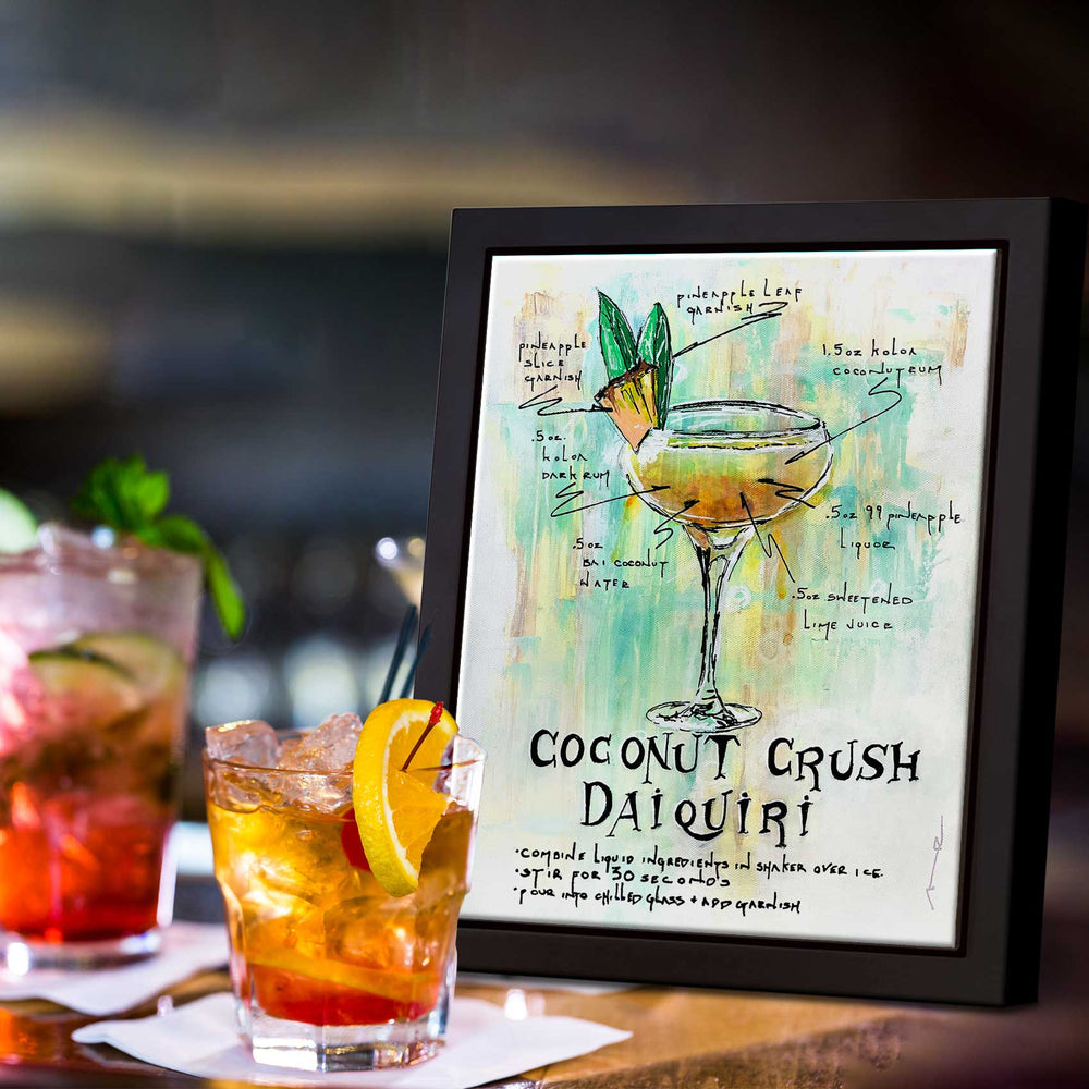 Framed cocktail wall art of Coconut Crush Daiquiri recipe with hand-drawn illustration in gold and green